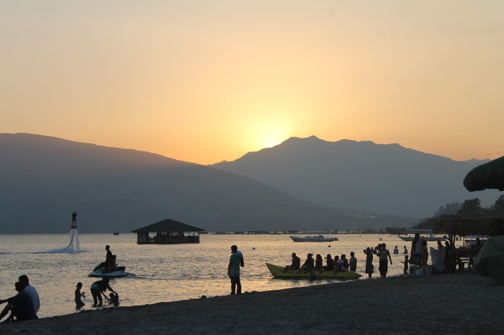 Mountains, sunset, banana boats, jet ski,  hoverboard,  restaurant in the middle of the sea.